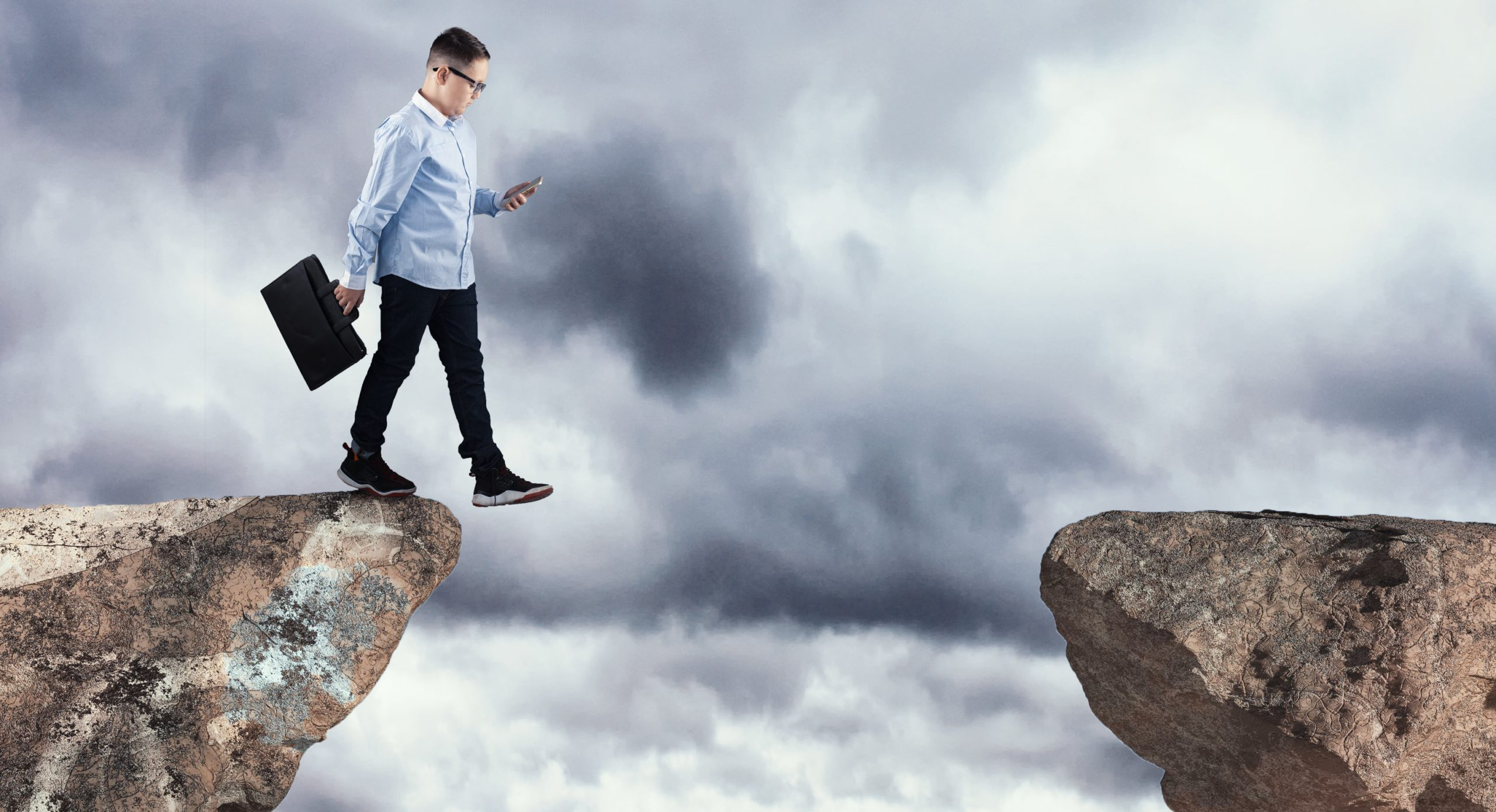 Walking into the abyss while using smartphone.